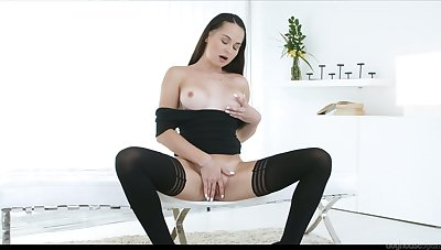 Lady in ebon burn the midnight oil and stockings Ashley Woods works on her wet pussy