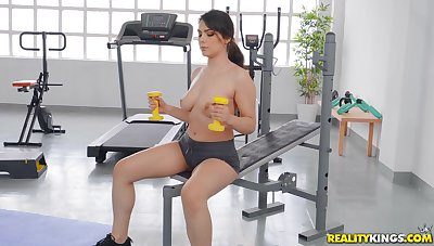 Busty girl works prevalent the dick upon at the gym