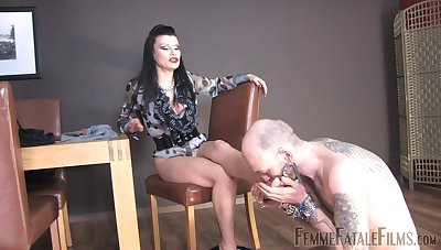 Miss Velour drills her pussy here a dildo while a slave licks her feet